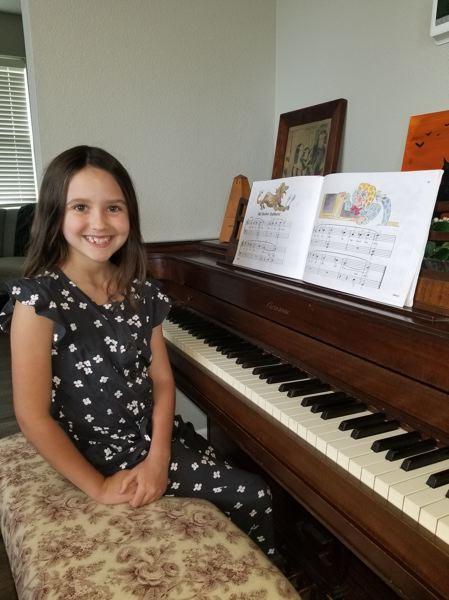 "COURTESY PHOTO - Clackamas River Elementary School second grader Emma Gaylor played ""Old Mother Hubbard"" on piano for the school's online talent show."