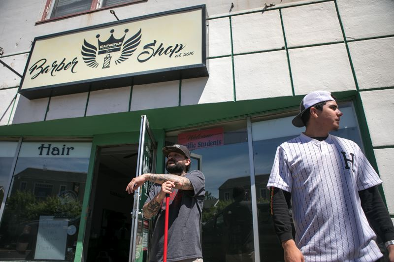PMG PHOTO: JAIME VALDEZ - David Esparza, left, owner of Faded Up Barber Shop in Forest Grove and his son-in-law, Jesus Calderon-Clark, 20, awaits the go ahead to reopen his shop.
