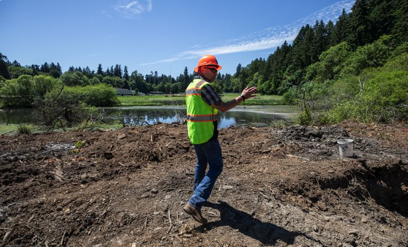 PMG PHOTO: JONATHAN HOUSE - Park Analyst Bruce Powers talks about the developments coming to Iron Mountain Park in Lake Oswego.