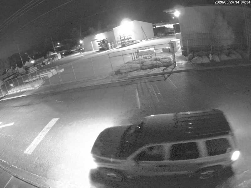 WOODBURN POLICE - Suspect is seen on surveillance video breaking a window, stealing a display case of knives and fleeing in a Dodge Durango.