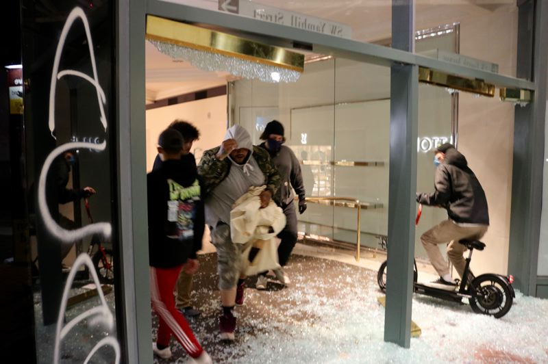 PMG PHOTO: ZANE SPARLING - Looting broke out and police declared a riot in downtown Portland during a protest for George Floyd on Friday, May 29.