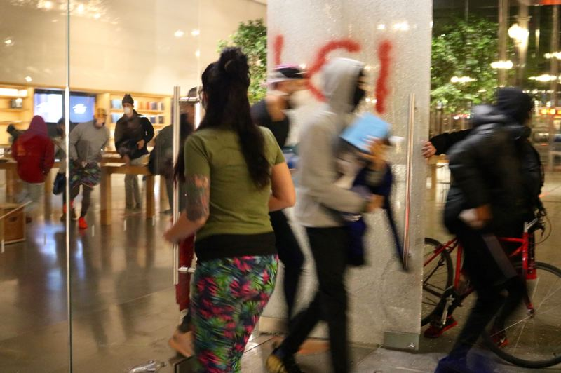 PMG PHOTO: ZANE SPARLING - Looters cleared out the merchandise after smashing windows at downtown Portland's flagship Apple store during a protest on Friday, May 29.