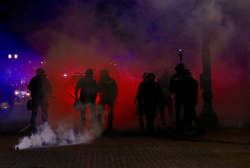 PMG PHOTO: ZANE SPARLING - Portland Police Bureau officers deployed rubber bullets, tear gas and flash bangs while clearing the streets of rioters on Friday, May 29.