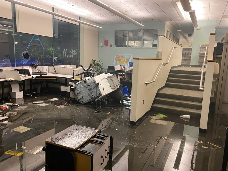COURTESY PHOTO: MULTNOMAH COUNTY SHERIFF'S OFFICE - Destruction to the Corrections Records Unit late Friday included water from sprinklers after looters set fire to the room.