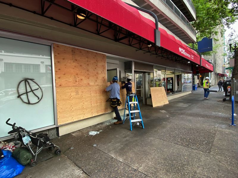 COURTESY PHOTO: PORTLAND BUSINESS ALLIANCE - Workers on Saturday, May 30, help clean up a storefront hit by rioters during the night.
