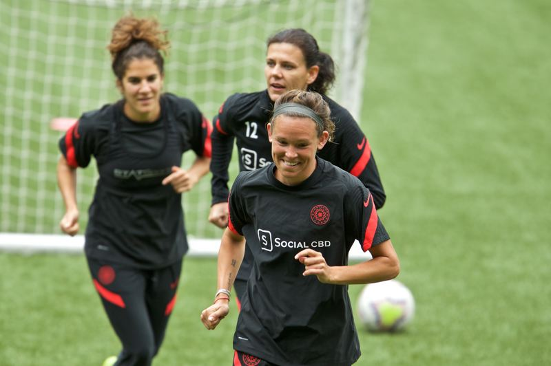 COURTESY PHOTO: PRTLAND THORNS/CRAIG MITCHELLDYER - Emily Menges (front), Christine Sinclair and Angela Salem participate in a drill on Saturday, May 30, during the Portland Thorns first full-team training session of 2020