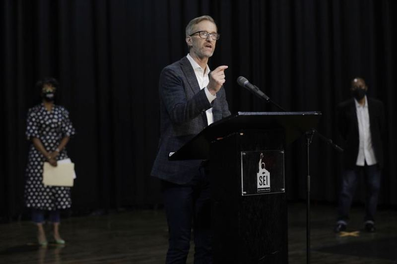 PMG PHOTO: JONATHAN HOUSE - Mayor Ted wheeler promised the African-American community the city will do better at a Sunday event at Self Enhancement Inc.