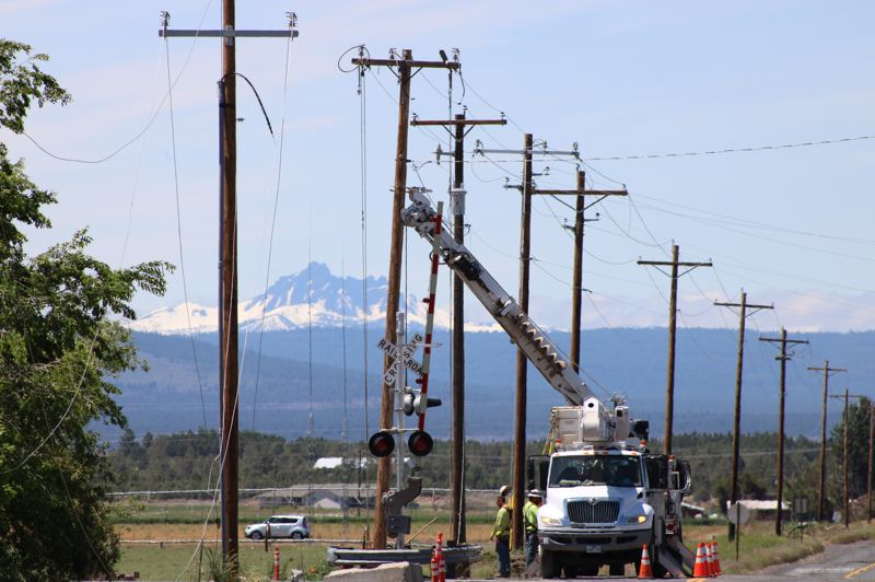 TERESA JACKSON/MADRAS PIONEER - Crews work to restore power in Culver on Sunday, May 31. Culver and Metolius were hardest hit in a major storm Saturday, May 30.