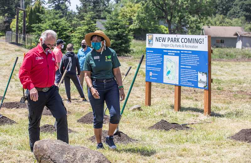 PMG PHOTO: JONATHAN HOUSE - Clackamas County Commissioner Ken Humberston chats with Oregon City Commissioner Denyse McGriff at the dedication of the Tyrone S. Woods Memorial Park.