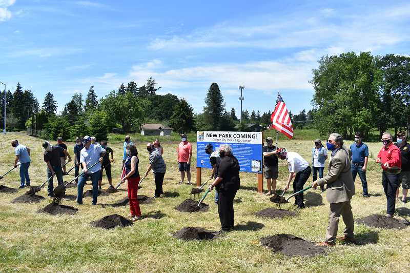 PMG PHOTO: RAYMOND RENDLEMAN - Elected representatives of Oregon City, Clackamas County Commissioner Ken Humberston, State Rep. Mark Meek, members of the citys Parks and Recreation Advisory Committee, Veterans of Foreign Wars Three Rivers Post 1324 members and construction contractors break ground on Tyrone S. Woods Memorial Park.