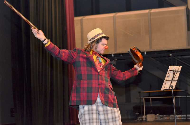 COURTESY PHOTO: CCC - Clackamas Community College theatre student Ian Graham plays a clown playing a violin during a recent performance.