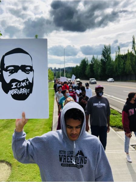 COURTESY PHOTO: AMAYA MEYER - Beaverton School District students and others march in Beaverton on Sunday afternoon, May 31, for a demonstration against racism in policing.