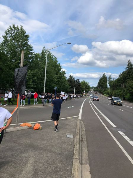 COURTESY PHOTO: BENITA MUNSON - Marchers against police brutality and racism reach the intersection of Southwest Scholls Ferry Road and Murray Boulevard in Beaverton on Sunday, May 31.