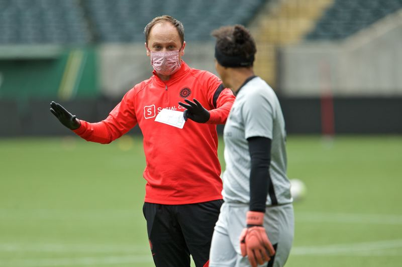COURTESY PHOTO: PORTLAND THORNS/CRAIG MITCHELLDYER - Coach Mark Parsons speaks with goalkeeper Adrianna Franch during a Portland Thorns training session on May 30 at Providence Park.