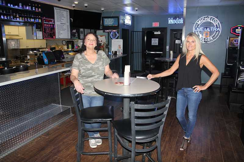 PMG PHOTO: JUSTIN MUCH - The Raven Bar & Grill owner Tina Wiltsey-Trevizo, right, and the bars manager Tracy Yazzolino welcomed the reopeing after taking advantage of statewide shutdown with a remodel and social-distancing adjustments.