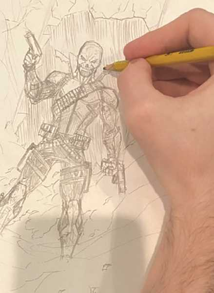 COURTESY PHOTO MITCHELL UNDERWOOD - At work on creating the Wraith characterm, Canby's Mitchell Underwood says he works on his comics constantly.