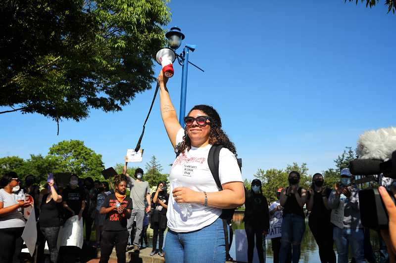 PMG PHOTO: JAIME VALDEZ - Markayla Ballard raises her arm to the hundreds of protesters who participated in the 'Justice for George Floyd' march on Tuesday, which began in the protest.