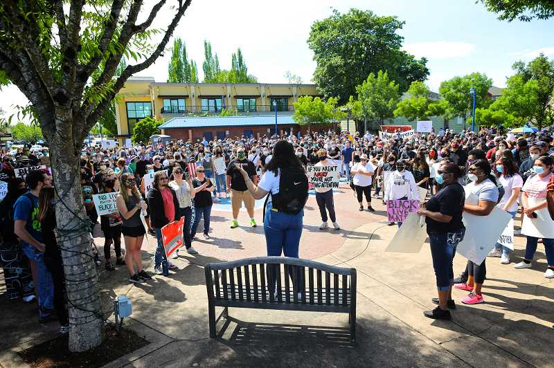 PMG PHOTO: JAIME VALDEZ - Markayla Ballard takes with hundreds of protesters at the Tualatin Lake of the Commons Tuesday before leading a march through downtown Tualatin.