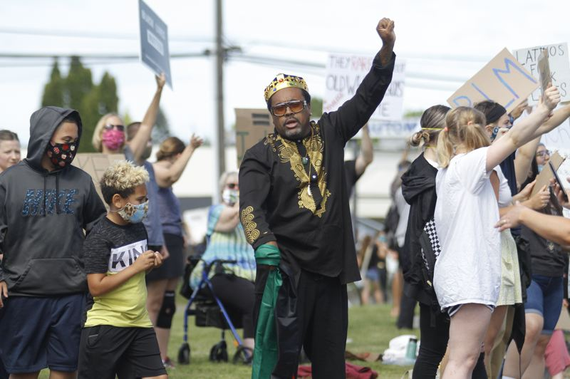 PMG PHOTO: WADE EVANSON - Anthony Washington of Forest Grove raises a fist in the air at a peaceful demonstration on Pacific Avenue Tuesday, June 2, to speak out against police brutality and systemic racism.