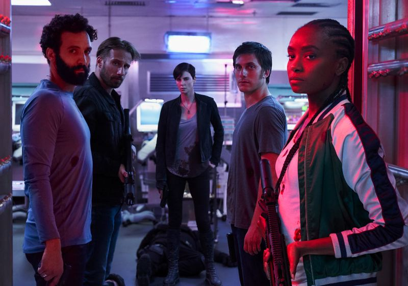 COURTESY PHOTO: AIMEE SPINKS/NETFLIX - 'The Old Guard' stars (from left) Marwan Kenzari, Matthias Schoenaerts, Charlize Theron (as lead character Andy), Luca Marinelli and KiKi Layne. It premieres July 10 on Netflix, and it could be a theatrical release later on.