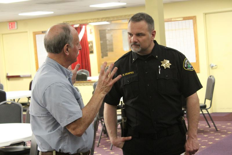 PMG PHOTO: COREY BUCHANAN - Wilsonville Police Chief Robert Wurpes (right) talks to a Rotary Club of Wilsonville member at a 2019 meeting.
