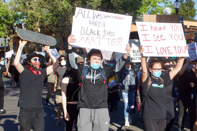 PMG PHOTO: CHRISTOPHER KEIZUR - Protestors chanted for justice and reform while they made their way to Gresham City Hall.