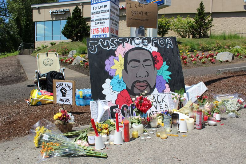 PMG PHOTO: HOLLY BARTHOLOMEW - West Linn protesters built a memorial to George Floyd calling for justice in his May 25 murder.