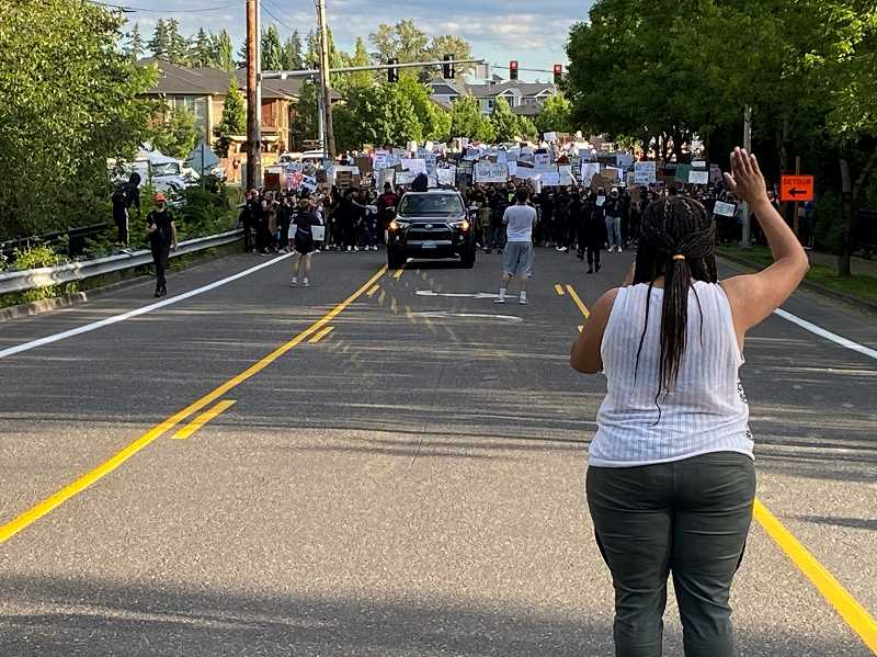 PMG PHOTO: SHELLEY MCFARLAND - State Rep. Janelle Bynum (right) leads a June 3 protest through her hometown of Happy Valley.