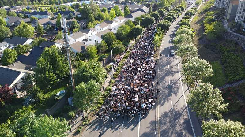 PMG PHOTO: ALVARO FONTAN - Crowds in the thousands were counted marching through Happy Valley on June 3.
