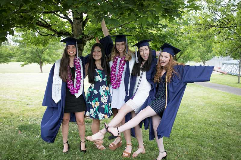 Leila Hilweh, Mia Carroll, Madeleine Klein, Sophia Villeneve and Anna Belle-McClelland pose for picture during graduation day at Wilsonville High School. Carroll who attended Wilsonville High School as a freshman and recently graduated from Canby High School often went to lunch with her friends which named themselves 'The lunch Bunch.'