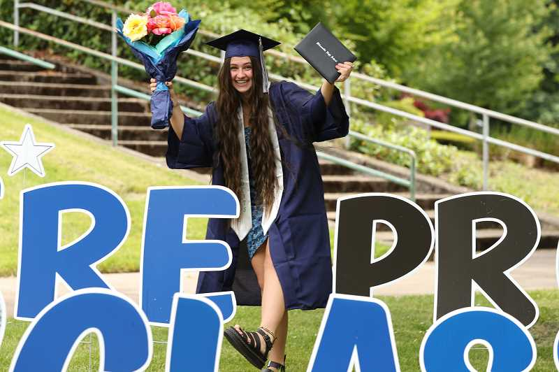PMG PHOTO: JAIME VALDEZ - Felicia Ricard poses for the camera after receiving her diploma at Wilsonville High School.