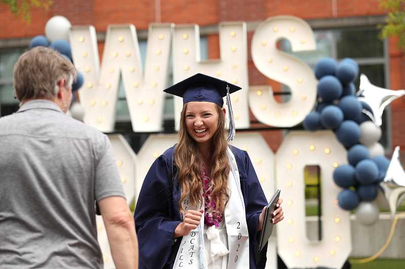 PMG PHOTO: JAIME VALDEZ - Linsey Hartford reacts after receiving her diploma at Wilsonville High School.