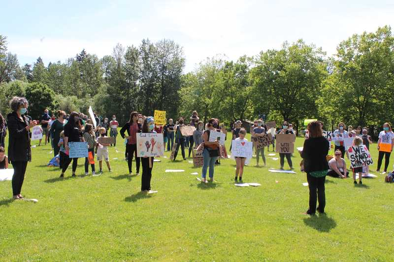 PMG PHOTO: HOLLY BARTHOLOMEW - Demonstrators listen as State Rep. Rachel Prusak speaks during Thursday's protest in Willamette Park.