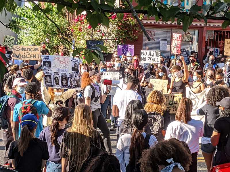 PMG PHOTO: COURTNEY VAUGHN - Protesters spill out onto Stark Street outside Revolution Hall in Portland Wednesday, June 3, where crowds chanted the names of black Americans killed by police. The massive crowd later marched into downtown for the sixth night in a row.