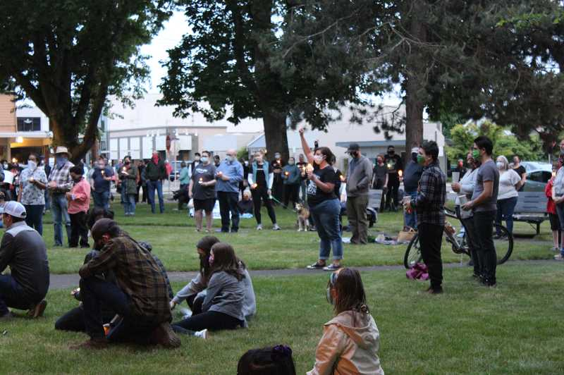 PMG PHOTO: KRISTEN WOHLERS - A crowd gathers in Canby's Wait Park at a vigil for George Floyd and other lives lost because of racism.