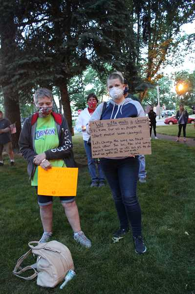 PMG PHOTO: KRISTEN WOHLERS - THe whole crowd was silent for nine minutes after leader Sara Hepler rang a bell.