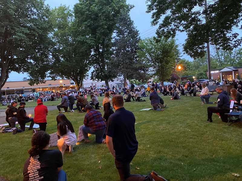 PMG PHOTO: KRISTEN WOHLERS - The whole crowd at Canby's Wait Park kneels for George Floyd and other lost.