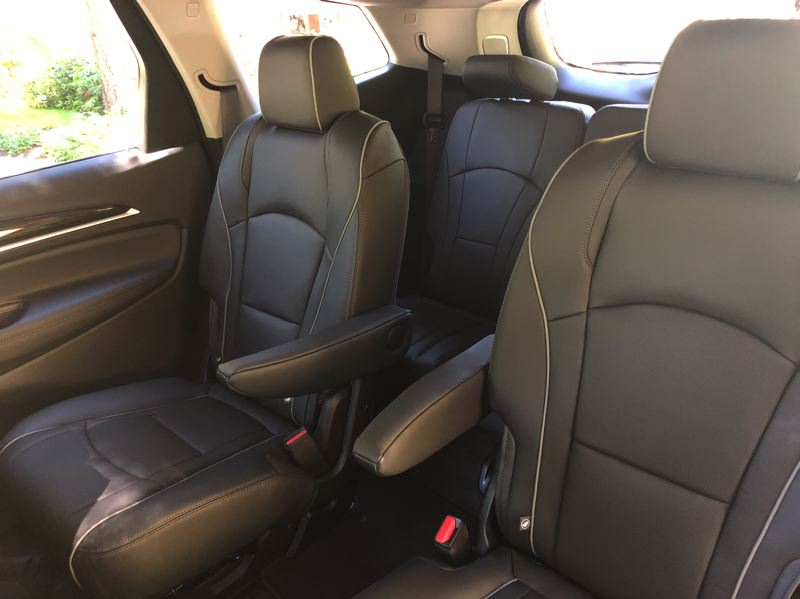 PMG PHOTO: JEFF ZURSCHMEIDE - The Buick Enclave Avenir is big enough to seat seven passengers in comfort and luxury.