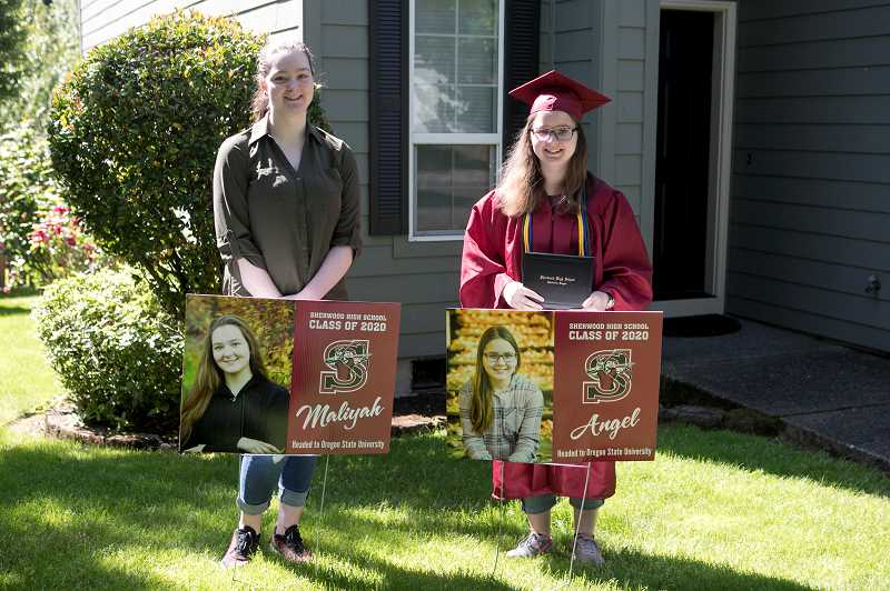 PMG PHOTO: JAIME VALDEZ - Twin sisters Maliyah and Angel Bowe, both seniors at Sherwood High School, graduated in two different ways. Angel, right, received her diploma from Principal Melissa Baran at her home Monday while Maliyah was planning to receive hers during a drive-up ceremony at the high school later this week.