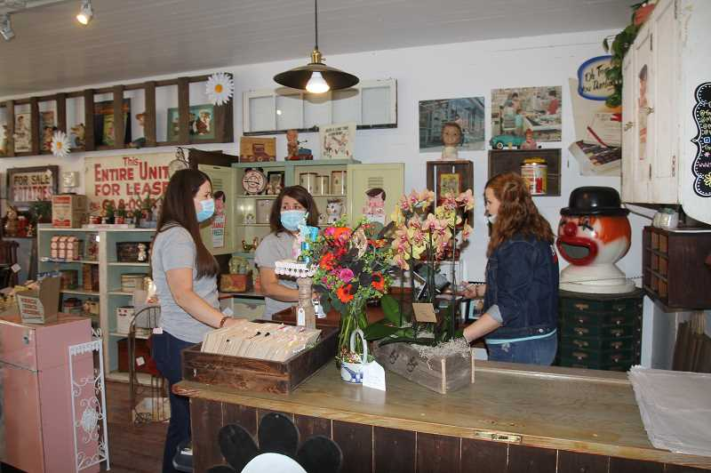 PMG PHOTO: JUSTIN MUCH - Three Daisies Vintage in Aurora opened recently by proprietors, left to right, Mackenzie Marcell, April Marcell and Kayla Marcell.