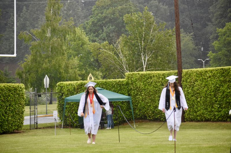 PMG PHOTO: EMILY LINDSTRAND - Soon-to-be Estacada High School graduates entered the stadium in pairs.