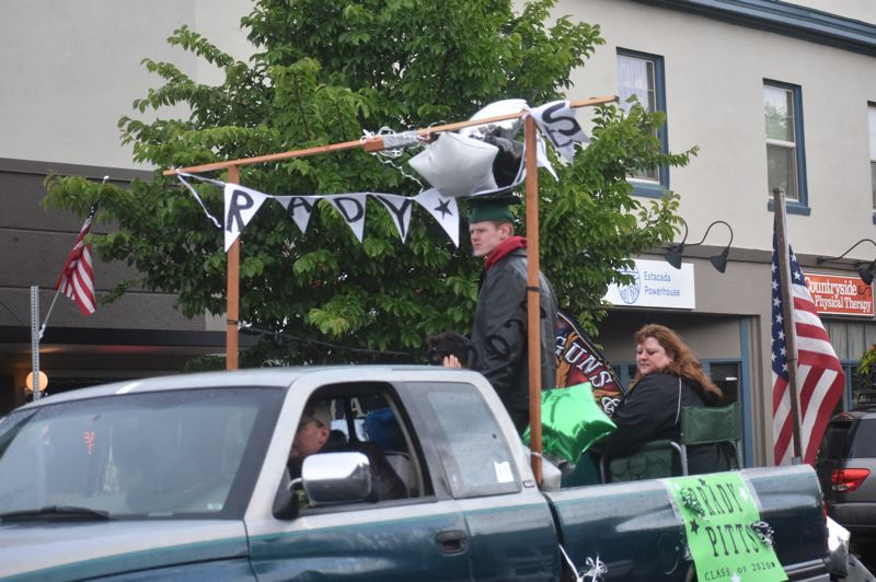 PMG PHOTO: EMILY LINDSTRAND - Vehicles decorated in honor of Estacada High School's class of 2020 made their way around town during a parade after the graduation ceremony.