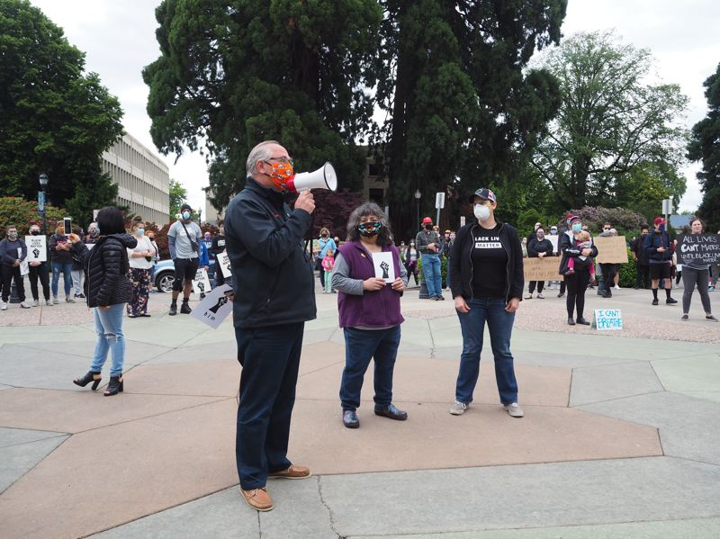PMG PHOTO: MAX EGENER - Hillsboro Mayor Steve Callaway, joined by city councilors Beach Pace and Olivia Alcaire, left, addresses protesters gathered at the Tom Hughes Civic Center Plaza on Friday, June 5.