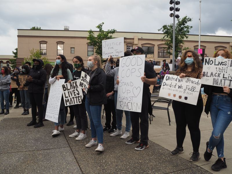 PMG PHOTO: MAX EGENER - Students holding signs in protest of police brutality and systematic racism at the Tom Hughes Civic Center Plaza in Hillsboro on Friday, June 5.
