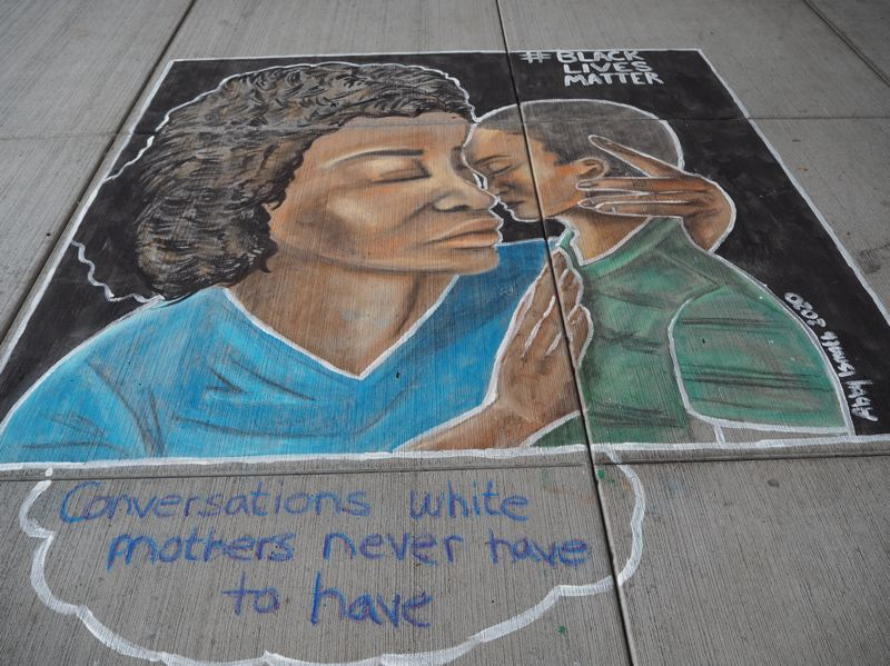 PMG PHOTO: MAX EGENER - A mural on the pavement of the Tom Hughes Civic Center Plaza in Hillsboro by local artist Abby Ismath.