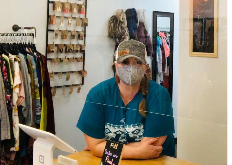 COURTESY PHOTO - Laura Smit at K's Clothing Boutique limits customers and sanitizes all merchandise and surfaces frequently to keep shoppers and her family safe.
