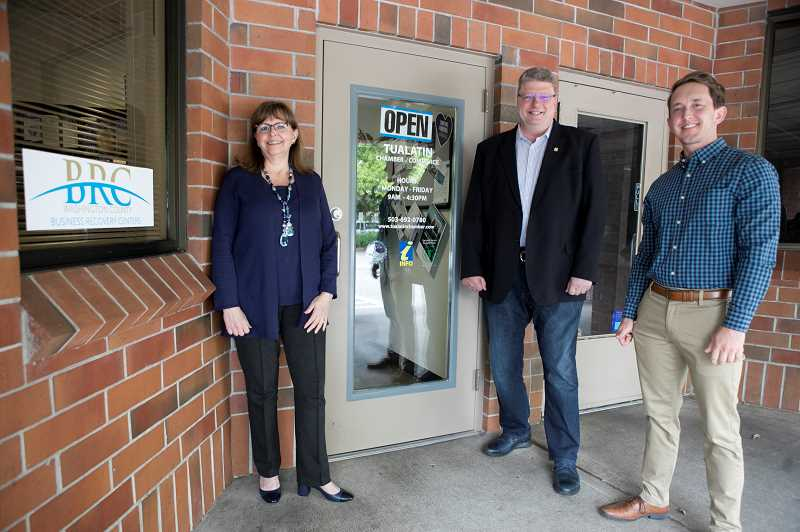 PMG PHOTO: JAIME VALDEZ - Tualatin Chamber of Commerce CEO Linda Moholt, left, Mayor Frank Bubenik and Economic Director Jonathan Taylor, stand in front of the Tualatin Chamber of Commerce, which has reserved space for one of the countys business recovery centers. Tualatin was the city that gave Washington County the idea for creating such a center, according to Taylor.