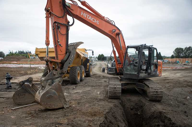 PMG PHOTO: JAIME VALDEZ - Construction equipment can be seen making new roads through the new West End development along Murray Boulevard at Tualatin Valley Highway. The former Kmart complex was torn down last year.
