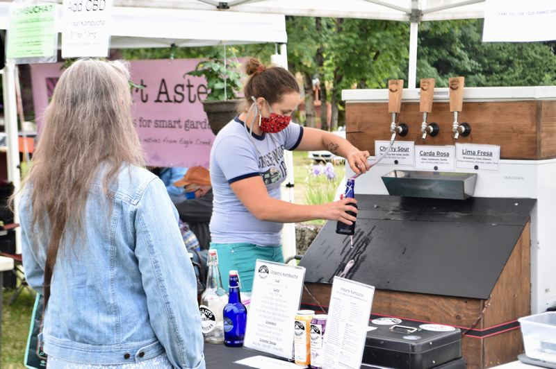 PMG PHOTO: BRITTANY ALLEN  - 4Hearts Kombucha was one of several vendors at opening day, serving up bottles and cans of kombucha sans tasting because of health concerns.