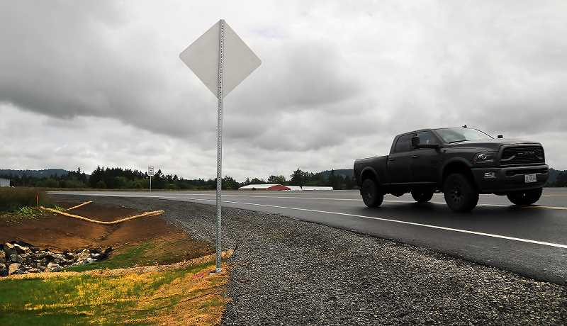 NEWBERG GRAPHIC: GARY ALLEN - The realignment of Wilsonville Road and its long-closed intersection with Highway 219 opened recently, but crews will continue to work on the thoroughfare for a few more weeks, ODOT officials said.